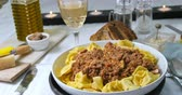 ground meat recipes : Dolly view of delicious steamy tortellini in bolognese sauce Stock Footage