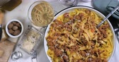 ground meat recipes : Dolly top down view of delicious steamy fettuccine in bolognese sauce
