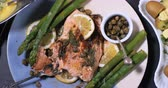 capers : Dolly top down view of a delicious roasted organic salmon with capers and dill Stock Footage