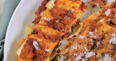 ground meat recipes : Dolly top down close up view of delicious steamy lasagne in bolognese sauce (pasta) Stock Footage