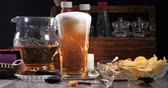 Pouring lager beer on a pint glass in a pub with head foam overflowing