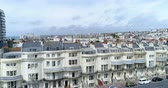Aerial ascending view of the town of Brighton and Hove looking West from a regency square Stock Footage