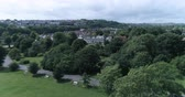 Aerial ascending view of the North part of the town of Brighton toward the sloping South Downs Stock Footage
