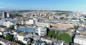 Aerial panning view of  the town of Brighton, England. From the train station to the beach and the Palace pier Stock Footage