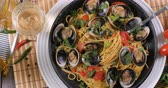 Dolly top down view of delicious Italian spaghetti alle vongole (clams) Stock Footage