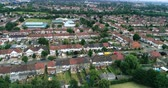 Aerial pull out view of suburban areas in North London (Wembley)