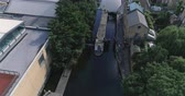 Aerial view over a lock in the Regents canal in London Stock Footage