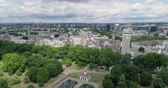Aerial pull out view of central London by the Italians gardens in Hyde park Stock Footage