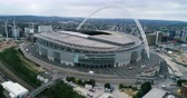 Aerial pull out view of Wembley stadium in North London Stock Footage