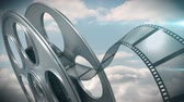 koncepty : Digitally generated of film reel against sky background