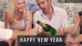 toasting : Happy man pouring champagne into his friends glasses on New Year Eve 4k