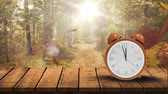 alarme : Digitally generated video of clock against bright autumn forest 4k