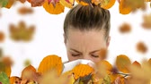 стенд : Digitally generated  video of woman with allergy sneezing and autumn leaves 4k