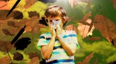 kichanie : Digital composite video of falling autumn leaves and boy sneezing while suffering from allergy 4k