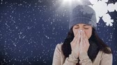 yünlü : Digital composite video of woman sneezing against snowflakes background 4k