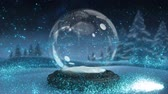 snow globe : Sparkling light spirally moving around the snow globe on winter landscape