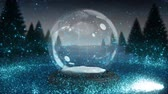 snow globe : Sparkling light spirally moving around the snow globe on snowy landscape 4k