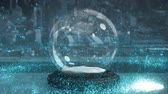 spirally : Sparkling light spirally moving around snow globe against cityscape background 4k Stock Footage
