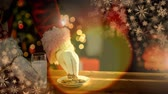dólares : Digital composite of Santa eating cookies and milk at Christmas home and glowing warmth