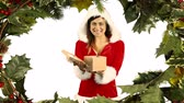 падуб : Digital composite of Santa woman opening gift with holly