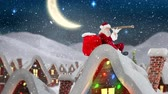 sack : Digital composite of Santa clause on a roof of a decorated house in winter scenery combined with falling snow