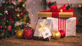 envolto : Digital composite of Falling snow with Christmas gifts decoration