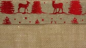 джут : Digital composite of Falling snow with Christmas textile reindeer