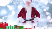 papai noel : Digital composite of Santa clause with christmas presents combined with falling snow Vídeos