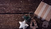jemioła : Digital composite of Falling snow with Christmas decorations and gift on wood
