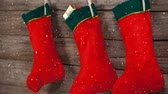 zęby : Digital composite of Falling snow with Christmas stockings decoration