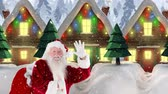sack : Digital composite of Santa clause in front of decorated houses combined with falling snow