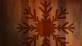 falling snow : Digital composite of Video composition with snow over Christmas ornaments on wood Stock Footage