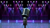 spotlight : Digital composite of Microphone with flashing lights for pop star Stock Footage