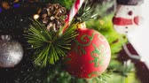pinha : Digital composite of Falling snow with Christmas tree decorations Stock Footage