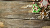 indulgence concept : Digital composite of Falling snow with Christmas cookies
