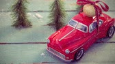 tied up : Digital composite of Red model car combined with falling snow Stock Footage