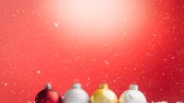 lined up : Digital composite of Falling snow with Christmas baubles decoration