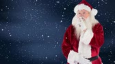papai noel : Digital composite of Santa clause combined with falling snow Stock Footage