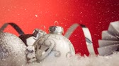 lentejoula : Digital composite of Falling snow with Christmas baubles decoration