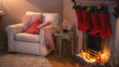 vime : Digital composite of Falling snow with Christmas home fire and stockings Stock Footage