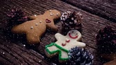 indulgence concept : Digital composite of Falling snow with Christmas cookie decorations