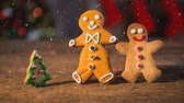 indulgence concept : Digital composite of Falling snow with Christmas gingerbread decoration