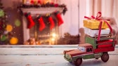 vime : Digital composite of Model car with christmas presents on its roof in a living room decorated for christmas combined with falling snow Stock Footage