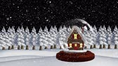 snow globe : Cute Christmas animation of illuminated hut. Snow falling over trees Stock Footage