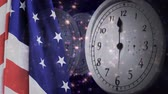 爆発的 : Digital animation of United States flag and wall clock. Fireworks in background 4k 動画素材