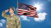 saluto militare : Digital animation of American soldier saluting against American flag. Swaying American flag against sky and cloud 4k Filmati Stock