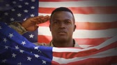 saluto militare : Digital animation of American soldier saluting against swaying American flag. American flag on foreground 4k