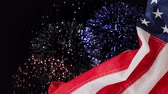 идентичность : Digital animation of fireworks display at night. American flag on foreground 4k