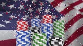 loteria : Digital animation of confetti falling on the pile of casino coins. American flag swaying in the wind 4k Vídeos