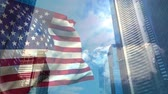 スクレーパー : Digital animation of American flag swaying in the wind against the bright sunlight. Skyscrapers below the blue sky on a sunny day 4K